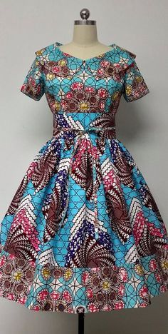 Mid-Low back. This is a fully lined multi fabric fitted waistline dress with rolled collar, Obi sash, and attached petticoat. African Dresses For Women, African Print Dresses, African Fashion Dresses, African Attire, African Wear, African Women, African Prints, African Style, African Fabric