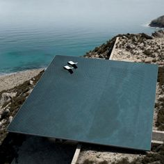 An infinity pool will form the roof of this cavernous house designed by Athens studio Kois Associated Architects for the Greek island of Tinos..