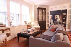 I love the dark cushioned table! Christeleny's Elegant and Eclectic Upper East Side Home