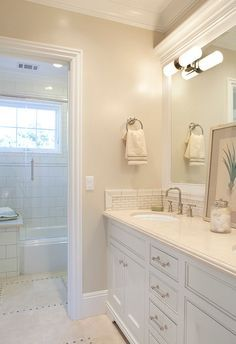 Wall paint color is Berber 955 by Benjamin Moore. Trims and Cabinets are Cotton Balls OC-122 by Benjamin Moore in semi-gloss. .