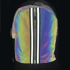 The fashion bag is made of Chinastars rainbow reflective fabric. It appears black in daylight, but at night when illuminated by light, it is able to show different reflective colors at different angles Fabric Bags, Sport Wear, Fashion Details, Color Patterns, Fashion Bags, Angles, Iridescent, Rainbow, Night