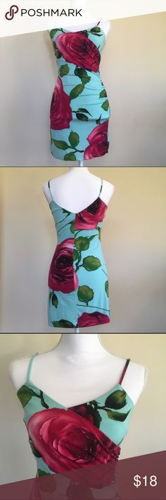 """Floral Summer Pencil Dress S Bright and Beautiful Dress. Perfect for the season. Amazing silhouette. Great stretchy floral material. Made of polyester and spandex blend. It has lining on. The bust measures 17"""", and the total lenght is 33"""". Love Tease Dresses"""