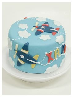 Red, Blue & Yellow Airplane Cake (Xavier) Más
