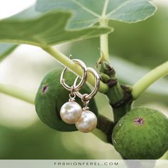 Add some gentle colour ro your ears. Gold plated with peachy pearl.