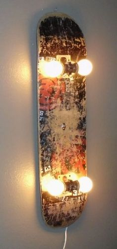 Skateboard Lamp Add lights to an old skateboard to make an urban wall lamp.