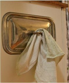 Reuse a discarded silver tray lid as a bar towel holder