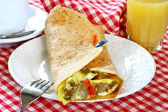SAUSAGE AND EGG BURRITO:  Servings: 1 Serving Time: 10-15 Minutes Ingredients: 1 vegetarian sausage link (1 ounce) 1/4 cup fat-free egg substitute or 1 large egg, beaten 1 whole wheat flour tortilla (8-inch round) 2 Tablespoons shredded reduced-fat Mexican blend or cheddar cheese 1 Tablespoon salsa (optional)