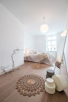 Fabulous bedroom draped in Scandinavian minimalism [Design: Wohn.Fee Home Staging]