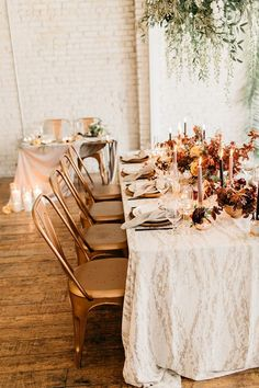 La Tavola Fine Linen Rental: Baylis Rain Gold with Tuscany Natural Napkins | Photography: Catie Coyle Photography, Venue: SF Studio Smith, Planning, Design, Calligraphy & Signage: Sweet + Crafty, Florals: Chestnut & Vine Floral Design, Rentals: Encore Events Rentals
