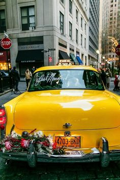Ride off in a yellow taxi - perfect for a city wedding! {Sean Gallery Photography}