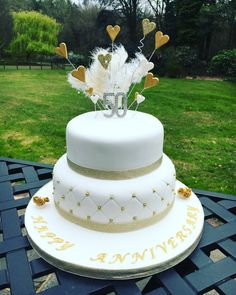 Golden wedding anniversary cake with feathers and quilting