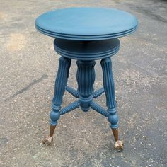 Not just for pianos anymore, this adjustable piano stool with four cast iron glass ball and claw feet has been repainted with a Federal Blue milk