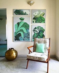 A gallery wall of mid-century modern artwork in gorgeous, vibrant green