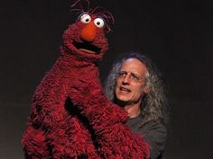 Martin P. Robinson is a puppeteer who has performed on Sesame Street since 1981. His characters include Telly Monster, Mr. Snuffleupagus and Slimey.