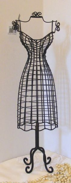 metal wire dress form.... This is my tattoo with added lovelies still need one for the house!