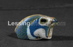 . A falcon's head. Imported from Egypt Glass, 18th Dynasty, New Kingdom