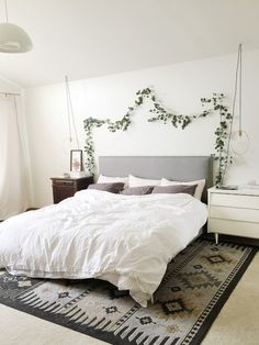 I was busy over the weekend putting the finishing touches on our decorations. Even though it feels like I put up less . Home Bedroom, Bedroom Wall, Bedroom Decor, Garden Bedroom, Above Headboard Decor, Ideias Diy, Minimalist Room, Condo Living, Eucalyptus Garland