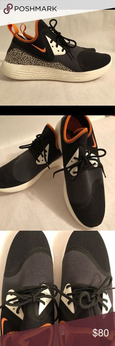 Nike LunarCharge safari Mens athletic shoes New Nike LunarCharge sneakers Size 10.5 Orange, Black, White with animal print accents Nike Shoes Sneakers