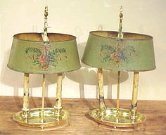 Charming 19th century Bouillotte lamps in brass with delicately decorated tole shades.