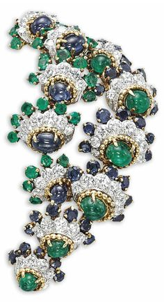 An emerald, sapphire and diamond brooch/pendant, by Van Cleef & Arpels. Photo Christie's Image Ltd 2013 Designed as two rows of. Van Cleef Arpels, Van Cleef And Arpels Jewelry, Amber Jewelry, Gems Jewelry, High Jewelry, Jewlery, Antique Jewelry, Vintage Jewelry, 14k White Gold Earrings