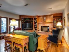 Before - this living room had fantastic bones, but was experiencing a case of Oak Overload.