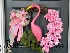 """Flamingo Wreath Spring Wreath Vintage Kitchy Styled Theme """"The Miami"""" Flamingo Art Door Decor Flamingo Retro Decor Wreath. $79.99, via Etsy."""