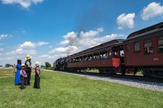 Amish time - Amish and train. Amish people in Pennsylvania. Amish are known for simple living with touch of nature contacy, plain dress, and reluctance to adopt conveniences of modern technology