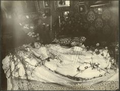 "A young girl laid out in the parlour. A house's parlor was also commonly referred to as the ""death room"". Up until the earlier part of the 20th century the laying out of the body and the funeral took place at home. Specifically in the death room. In 1910 The Ladies Home Journal declared that the ""death room"" was finished. Henceforth we began referring to it as the ""living room""."