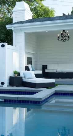 Villa Discover White Poolside Cabana Features Modern Chandelier Among Relaxing Outdoor Entertaining Area Backyard Pool Landscaping, Backyard Pool Designs, Swimming Pools Backyard, Swimming Pool Designs, Pool House Designs, Lap Pools, Luxury Swimming Pools, Dream Pools, Luxury Pools
