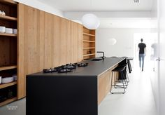 Photo 4 of 24 in 23 Kitchen Countertops That Serve Up Good Design from Minimal Home Recreates Nature in the Heart of Amsterdam - Consider putting stove & sink in (less heavy) island & cabinets against/around the wall.