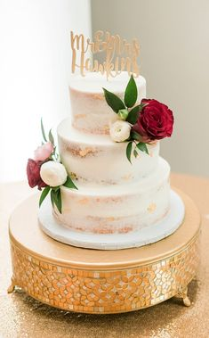 Three tiered semi naked wedding cake with gold flakes and custom cake topper and floral decorations on a mirrored gold cake stand for a classic wedding in Richmond Virginia #weddingcake #cake #desserts #nakedcake #caketopper #etsy #floral #flowers #cakeideas #wedding #weddingideas Wedding Programs, Wedding Themes, Wedding Cakes, Hamburger Party, Gold Cake Stand, British Slang, Floral Decorations, African American Weddings, Incredible Edibles