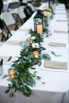 Gorgeous centre pieces made from candles, tealight holders & a foliage runner