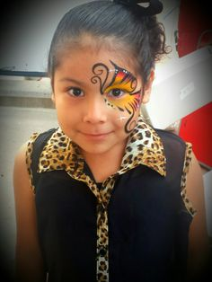 Butterfly face painting by FunnyCheeksTJ, Dallas Face Painter