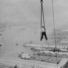 14 Nerve-Wracking Photos From High Atop Old School NYC Skyscrapers: Gothamist A construction worker is hauled up to his place of work on a 30 storey skyscraper on New York's waterfront, 1890.(Getty Images)