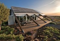 Experimental Bioclimatic House on Canary Islands, Spain by Jose Luis Rodriguez Gil.  Self-sufficient home using solar for hot water & electricity.