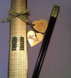Chopsticks favor from Chinese Wedding reception - Gold double happiness wrapping, Ebony colored wooden chopsticks