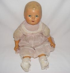 Early 1900's Reliable Canadian Composition doll in original clothing....