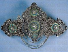 Woman's belt buckle;  From Turkey or Southern Bulgaria, late-Ottoman, ca. end of 18th century.  Silver filigree and enamel. (Private collection).