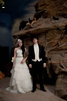 LOVE the bouquet! Antlers and top hats and dinosaurs, oh my! A natural history museum wedding