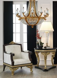Elegant setting, using the chair and side table from Volga Collection, produced in walnut burl veneer with sycamore inlays, hand carved gilded wood and ornaments in gold plated casted bronze. The chandelier from the Royal Heritage Collection, made in bronze, decorated with Swarovski elements, with 30 lights and french gold finish. Mariner Luxury Furniture & Lighting