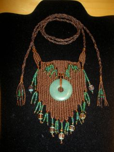 """Jade Donut"" - 2013 - Adjustable length, Jade donut centerpiece, SOLD.  Woven by Terri Scache Harris, theravenscache.shutterfly.com   Hand woven, handwoven, weaving, weave, needleweaving, pin weaving, woven necklace, fashion necklace, wearable art,fiber art."