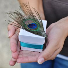Check out the wedding favor boxes we created for the Invitations by Dawn blog to demonstrate how brides can make DIY favors that fit their style! Mine is the peacock box :)