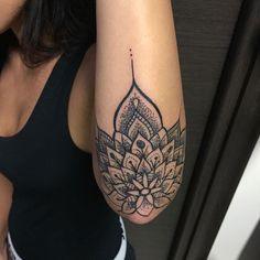 Mandala tattoo back hand