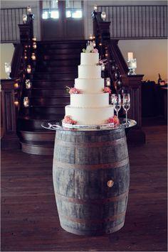 classic wedding cake on a wine barrel cake stand