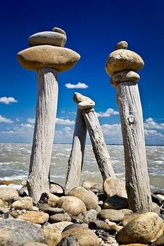 going to Beauduc, France ~ there are many roads protected from erosion with these wood poles. people just enjoy piling flat stones over them ~ © Philippe Targouriech