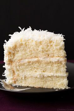 Coconut Cake by Cooking Classy. Incredibly soft, moist, and layered with cream cheese frosting!