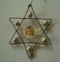 ANTIQUE BOHEMIAN GLASS BEADED AND WRAPPED WIRE STAR WITH ANGEL XMAS ORNAMENT