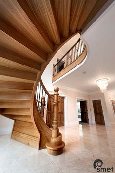 We convinced our Clients that they did not need an in situ cast concrete stair flight to achieve their dream staircase.  We brought in this solid French Oak fully curved and free standing staircase instead. The wrought iron spindles have an old bronze finish for maximum 'wow' effect.