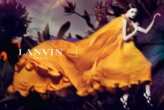 Lanvin Spring Summer 2008 Ad Campaign. The ss08 Lanvin ad campaign highlights the same idea: the surreal shades, the giant flowers landscape creates a fairy tale, a very mysterious and sophisticated one. I can't help thinking, though, that the image of filiform Olga Sherer posing in that gorgeous long, flowing, golden dress reminds me of a praying mantis.