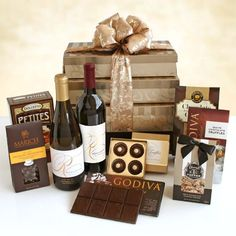 Elegant California Wine and Chocolate Gift Tower - This sophisticated pewter toned gift tower makes a grand impression. Three glittering boxes are stacked and filled with the finest from California.  - http://giftbasketblessings.com/product/elegant-california-wine-and-chocolate-gift-tower/